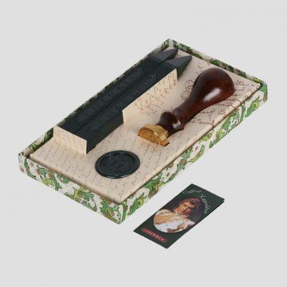 Boîte contenant 1 Sceau Monogramme Napoléon avec 2 bâtons de cire verte et un dépliant